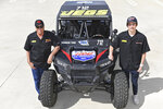 This March 9, 2019, photo provided by Auto Imagery shows former drag racer Don Prudhomme, left, and Jagger Jones at the Snake Racing Performance Shop in Vista, Calif. Prudhomme swore he would never enter the Mexican 1000 again after struggling to get through the difficult off-road race in Baja California. A year later, The Snake is tackling it again, this time with 16-year-old Jagger Jones at his side.(Richard Shute/Auto Imagery via AP)