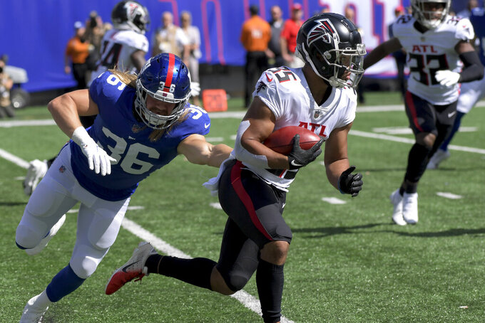 Atlanta Falcons cornerback Avery Williams (35) breaks away from New York Giants running back Cullen Gillaspia (36) on the run during the first half of an NFL football game, Sunday, Sept. 26, 2021, in East Rutherford, N.J. (AP Photo/Bill Kostroun)