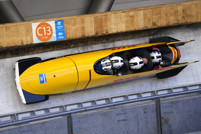 Francesco Friedrich, Thorsten Margis, Candy Bauer, and Alexander Schueller of Germany compete in the four-man bobsleigh during an IBSF Sanctioned Race, a test event for the 2022 Winter Olympics, at the Yanqing National Sliding Center in Beijing, Tuesday, Oct. 26, 2021. (AP Photo/Mark Schiefelbein)