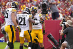 Iowa wide receiver Charlie Jones (16) celebrates touchdown with Iowa defensive lineman Logan Lee (85) and Iowa running back Ivory Kelly-Martin (21) during the first half of an NCAA college football game against Iowa State, Saturday, Sept. 11, 2021, in Ames, Iowa. (AP Photo/Matthew Putney)