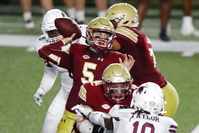 Boston College quarterback Phil Jurkovec (5) throws a pass during the first half of the team's NCAA college football game against Texas State, Saturday, Sept. 26, 2020, in Boston. (AP Photo/Michael Dwyer)