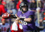 FILE - In this Saturday, Oct. 13, 2018, file photo, Northwestern's Clayton Thorson throws a pass during an NCAA college football game in Evanston, Ill. Northwestern (4-3) somehow, some way is 4-1 in Big Ten play for the first time since 2000 and a half-game ahead of Wisconsin, Purdue and Iowa in the West. (AP Photo/Jim Youn, File)