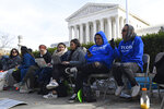 People wait in line outside the Supreme Court in Washington, Monday, Nov. 11, 2019, to be able to attend oral arguments in the case of President Trump's decision to end the Obama-era, Deferred Action for Childhood Arrivals program (DACA). (AP Photo/Susan Walsh)