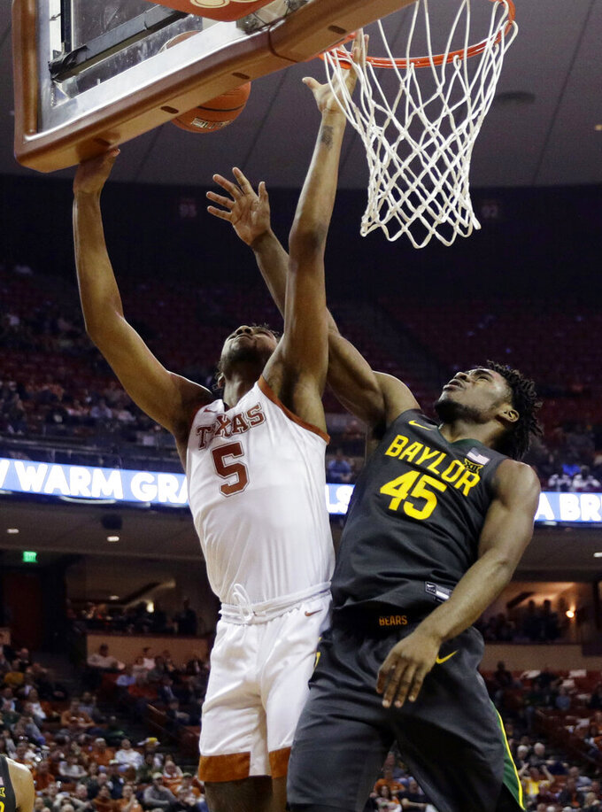 Texas forward Royce Hamm Jr. (5) is blocked by Baylor guard Davion Mitchell (45) during the second half of an NCAA college basketball game, Monday, Feb. 10, 2020, in Austin, Texas. (AP Photo/Eric Gay)