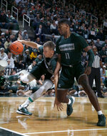 Michigan State's Thomas Kithier, left, drives against Aaron Henry (11) during the NCAA college basketball team's scrimmage Friday, Oct. 25, 2019, in East Lansing, Mich. (AP Photo/Al Goldis)
