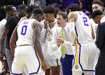 LSU head coach Will Wade, center, pumps up his team before the start of the first half of an NCAA college basketball game against Alabama, Wednesday, Jan. 29, 2020, in Baton Rouge, La. LSU won 90-76. (AP Photo/Bill Feig)