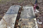 This Dec. 10, 2019, photo shows the headstones of Josiah Clark, a Revolutionary War soldier, and his wife, that were removed from a cemetery near the edge of an eroding river bank in Weybridge, Vt. Rising seas, erosion and flooding from worsening storms that some scientists believe are caused by climate change are putting some older graveyards across the country at risk. (AP Photo/Lisa Rathke)