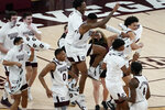 Mississippi State players celebrate a 78-63 win over Missouri in an NCAA college basketball game Tuesday, Jan. 5, 2021, in Starkville, Miss. (AP Photo/Rogelio V. Solis)