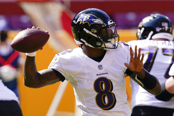 Baltimore Ravens quarterback Lamar Jackson (8) works against the Washington Football Team during the first half of an NFL football game, Sunday, Oct. 4, 2020, in Landover, Md. (AP Photo/Susan Walsh)