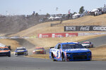 Kyle Larson (5) leads the pack through the s-curves during a NASCAR Cup Series auto race, Sunday, June 6, 2021, at Sonoma Raceway in Sonoma, Calif. (AP Photo/D. Ross Cameron)