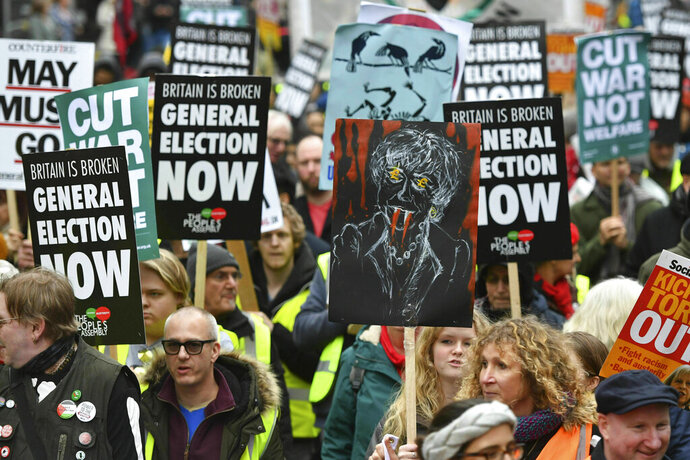 People's Assembly Against Austerity stage a  rally in central London calling for a general election. Saturday Jan. 12, 2019. Hundreds of protesters inspired by France's so-called 'yellow vest' movement are rallying in Britain, drawing attention to austerity programs that have hit the poor hard. (Dominic Lipinski/PA via AP)