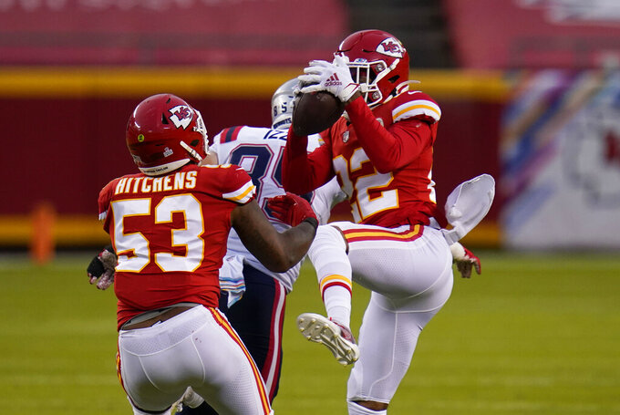 Kansas City Chiefs safety Juan Thornhill, right, intercepts a pass in front of teammate Anthony Hitchens (53) during the first half of an NFL football game against the New England Patriots, Monday, Oct. 5, 2020, in Kansas City. (AP Photo/Jeff Roberson)
