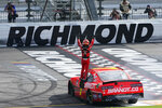 Justin Allgaier (7) celebrates after winning a NASCAR Xfinity Series auto race Saturday, Sept. 12, 2020, in Richmond, Va. Allgaier swept the two days of racing in the Xfinity Series. (AP Photo/Steve Helber)