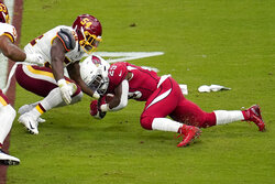 Arizona Cardinals running back Chase Edmonds (29) is stopped by Washington Football Team linebacker Kevin Pierre-Louis during the first half of an NFL football game, Sunday, Sept. 20, 2020, in Glendale, Ariz. (AP Photo/Ross D. Franklin)