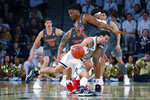Georgia Tech guard Jose Alvarado (10) drives to the basket against Louisville center Steven Enoch (23) during the first half of an NCAA college basketball game in Atlanta, Wednesday, Feb. 12, 2020. (AP Photo/Todd Kirkland)