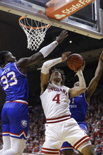 Indiana's Trayce Jackson-Davis (4) puts up a shot against Louisiana Tech's Andrew Gordon (33) and Derric Jean (1) during the first half of an NCAA college basketball game, Monday, Nov. 25, 2019, in Bloomington, Ind. (AP Photo/Darron Cummings)