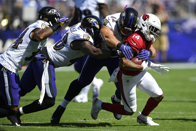 Arizona Cardinals wide receiver Damiere Byrd, right, rushes against Baltimore Ravens cornerback Anthony Averett, from left, inside linebacker Patrick Onwuasor and defensive lineman Patrick Ricard in the first half of an NFL football game, Sunday, Sept. 15, 2019, in Baltimore. (AP Photo/Nick Wass)