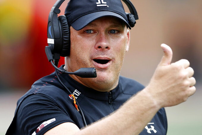 FILE - In this Sept. 15, 2018, file photo, Temple head coach Geoff Collins gestures in the second half of an NCAA college football game against Maryland, in College Park, Md. Georgia Tech has hired Temple coach Geoff Collins to replace Paul Johnson as the Yellow Jackets coach. Collins, a Conyers, Georgia native, is a former Florida and Mississippi State defensive coordinator who was 15-10 in two seasons at Temple. Georgia Tech announced the hire on Friday, Dec. 7, 2018,  and planned a news conference for later in the day. (AP Photo/Patrick Semansky, File)