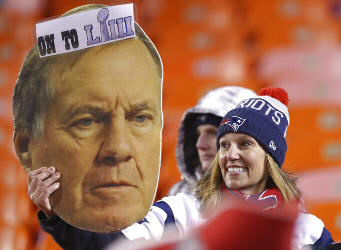 Fans celerbrate after the New England Patriots defeated the Kansas City Chiefs in the AFC Championship NFL football game, Sunday, Jan. 20, 2019, in Kansas City, Mo. (AP Photo/Charlie Neibergall)