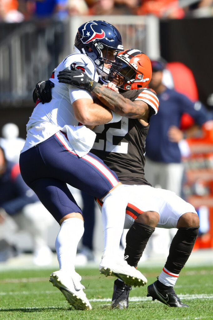 Houston Texans quarterback Davis Mills, left, is sacked by Cleveland Browns safety Grant Delpit during the second half of an NFL football game, Sunday, Sept. 19, 2021, in Cleveland. (AP Photo/David Richard)