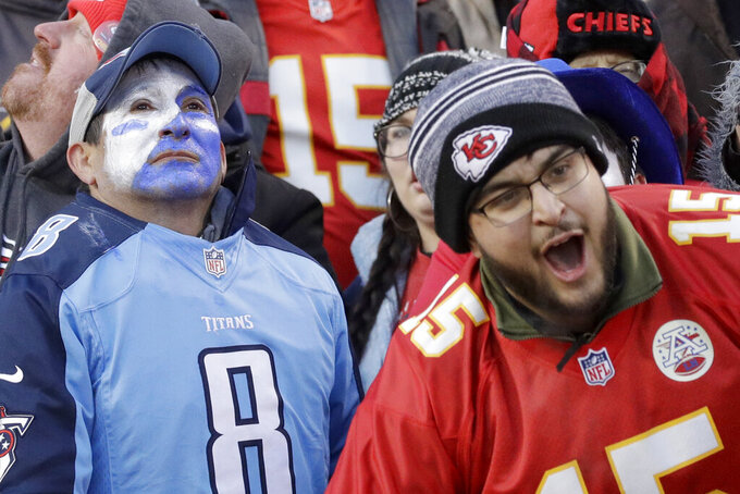 Fans reacts after the NFL AFC Championship football game against the Tennessee Titans Sunday, Jan. 19, 2020, in Kansas City, MO. The Chiefs won 35-24 to advance to Super Bowl 54. (AP Photo/Charlie Riedel)