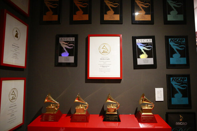 Awards hang on the wall in Colombian producer Julio Reyes Copello's new Abbey Road Institute on Tuesday, Feb. 25, 2020, in Miami. The Abbey Road Institute announced that it will open its first music school in the United States in partnership with Copello. (AP Photo/Brynn Anderson)