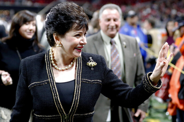 "FILE - In this Thursday, Nov. 28, 2019 file photo, New Orleans Saints owner Gayle Benson waves to the crowd before the first half of an NFL football game between the Atlanta Falcons and the New Orleans Saints in Atlanta. Benson, who inherited the team following her husband Tom Benson's 2018 death, said the team's senior vice president of communications advised Archbishop Gregory Aymond to be ""honest, complete and transparent"" about clergy abuse. (AP Photo/John Bazemore)"
