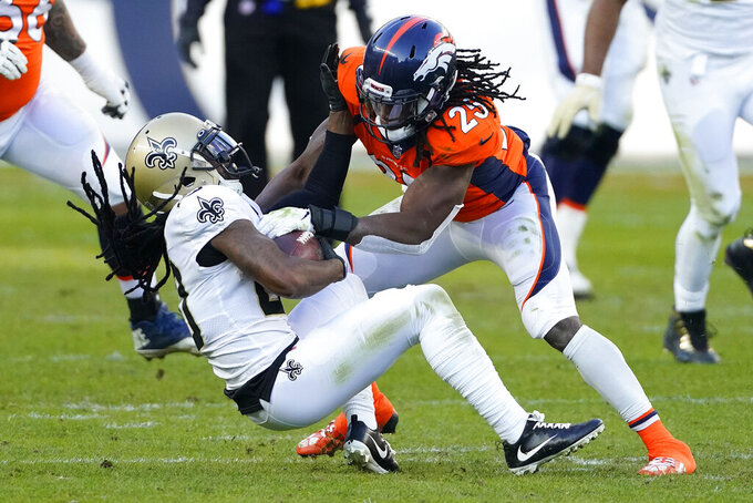 Denver Broncos running back Melvin Gordon (25) tackles New Orleans Saints cornerback Janoris Jenkins after Jenkins intercepted a pass during the first half of an NFL football game, Sunday, Nov. 29, 2020, in Denver. (AP Photo/Jack Dempsey)