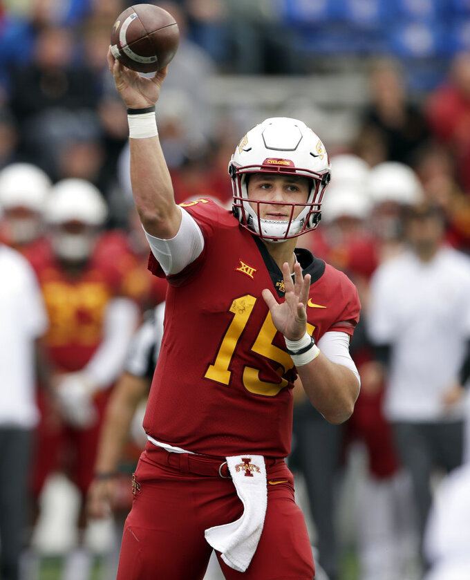 Iowa State quarterback Brock Purdy (15) passes to a teammate during the second half of an NCAA college football game against Kansas in Lawrence, Kan., Saturday, Nov. 3, 2018. (AP Photo/Orlin Wagner)