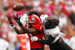 Arkansas State cornerback Jerry Jacobs, right, breaks up a pass intended for Georgia wide receiver George Pickens, left, in the first half of an NCAA college football game Saturday, Sept. 14, 2019, in Athens, Ga. (AP Photo/John Bazemore)