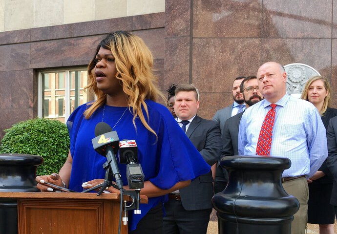 Lead plaintiff Kayla Gore speaks at a news conference outside the federal courthouse in Nashville, Tenn., Tuesday, April 23, 2019. She announced a lawsuit challenging a Tennessee statute that prohibits transgender people from changing the gender listed on their birth certificates. (AP Photo/Travis Loller)