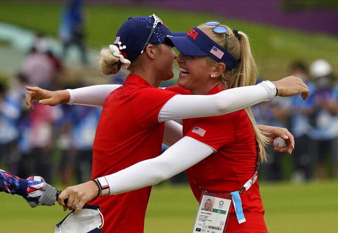Nelly Korda, of the United States, left, celebrates with her sister Jessica Korda after winning the gold medal on the 18th hole during the final round of the women's golf event at the 2020 Summer Olympics.during the final round of the women's golf event at the 2020 Summer Olympics, Saturday, Aug. 7, 2021, at the Kasumigaseki Country Club in Kawagoe, Japan. (AP Photo/Matt York)