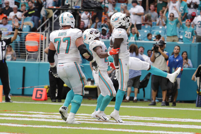 Miami Dolphins wide receiver Preston Williams (18) celebrates after scoring a touchdown during the first half of an NFL football game against the New York Jets, Sunday, Nov. 3, 2019, in Miami Gardens, Fla. (AP Photo/Lynne Sladky)