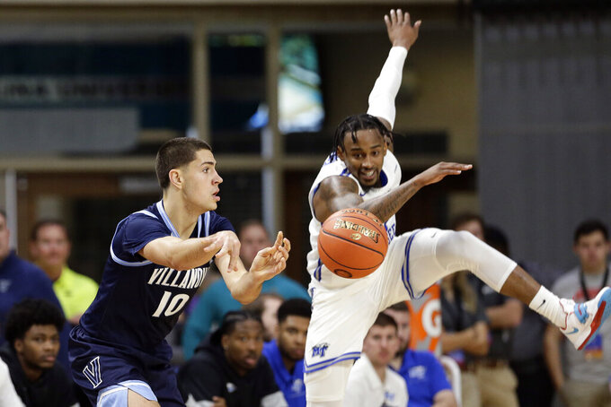 Villanova forward Cole Swider (10) passes as Middle Tennessee State guard Antonio Green watches during the first half of an NCAA college basketball game at the Myrtle Beach Invitational in Conway, S.C., Thursday, Nov. 21, 2019. (AP Photo/Gerry Broome)