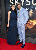 Actor Dwayne Johnson and daughter Simone Johnson attend the