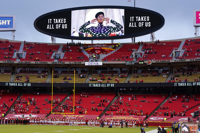 Kansas City Chiefs players and fans stand as a song by Alicia Keys is played during a presentation on social justice before an NFL football game against the Houston Texans Thursday, Sept. 10, 2020, in Kansas City, Mo. (AP Photo/Jeff Roberson)