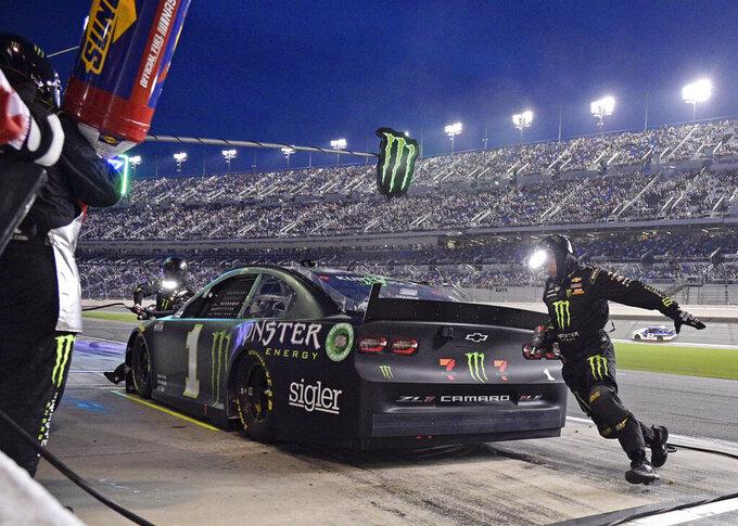 Kurt Busch makes a pit stop in the early laps of the NASCAR Cup Series auto race at Daytona International Speedway, Saturday, Aug. 28, 2021, in Daytona Beach, Fla. (AP Photo/Phelan M. Ebenhack)