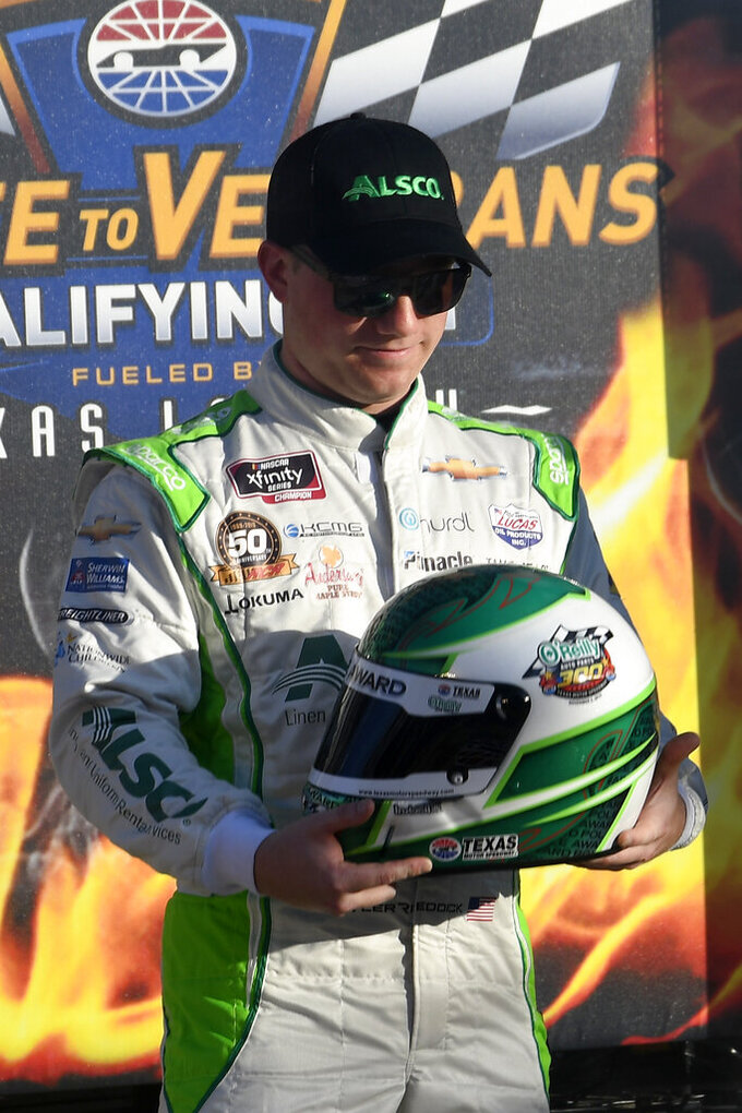 Tyler Reddick stands in Victory Lane after winning the pole for the NASCAR Xfinity Series auto race at Texas Motor Speedway in Fort Worth, Texas, Saturday, Nov. 2, 2019. (AP Photo/Larry Papke)