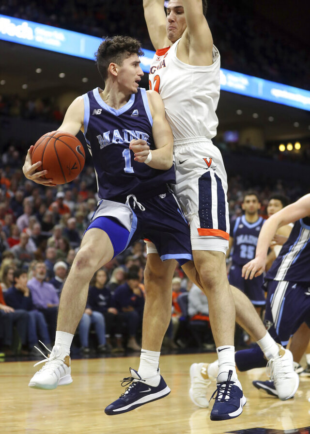 Maine guard Mykhailo Yagodin (1) attempts to pass the ball around Virginia center Francisco Caffaro (22) during an NCAA college basketball game in Charlottesville, Va., Wednesday, Nov. 27, 2019. (AP Photo/Andrew Shurtleff)