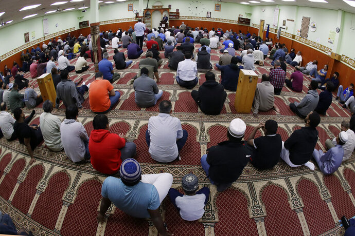 In this Oct. 18, 2019, photo, Kurds attend Friday prayers at the Salahadeen Center in Nashville, Tenn. Nashville has the largest Kurdish population in the U.S. The community of up to 40,000 Kurds has felt largely helpless to aid their homeland of late, as images of death and despair invade social media. Many feel a new level of betrayal by President Donald Trump after watching Turkey attack their people and push them out of Syria. (AP Photo/Mark Humphrey)