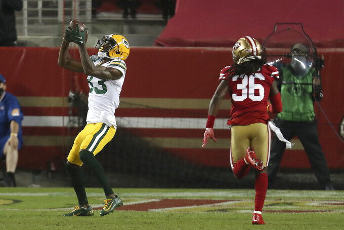 Green Bay Packers wide receiver Marquez Valdes-Scantling, left, catches a touchdown pass in front of San Francisco 49ers safety Marcell Harris (36) during the first half of an NFL football game in Santa Clara, Calif., Thursday, Nov. 5, 2020. (AP Photo/Jed Jacobsohn)