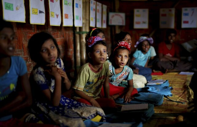 FILE- In this Aug. 27, 2018, file photo, Rohingya refugee children attend a UNICEF run school in Balukhali refugee camp, Bangladesh. Authorities in Bangladesh in partnership with the United Nations will expand educational programs for hundreds of thousands of Muslim Rohingya children living in refugee camps who are currently receiving only basic lessons, officials said Wednesday, Jan. 29, 2020. (AP Photo/Altaf Qadri, File)