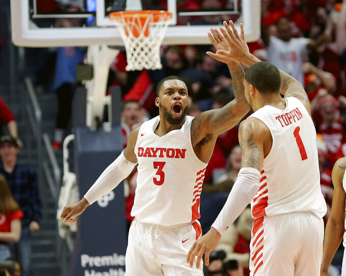 Dayton's Trey Landers (3) and Obi Toppin (1) celebrate during the second half of an NCAA college basketball game against George Washington, Saturday, March 7, 2020, in Dayton, Ohio. (AP Photo/Tony Tribble)