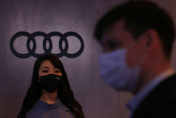 A worker prepares for press day at the Audi booth during Shanghai Auto Show in Shanghai on Monday, April 19, 2021. Automakers are looking to China, their biggest market by sales volume and the first major economy to rebound from the pandemic, to revive sales and reverse multibillion-dollar losses. (AP Photo/Ng Han Guan)