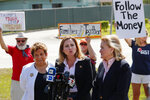 Rep. Debbie Mucarsel-Powell, D-Fla., center, speaks to members of the media about her tour of the Homestead Temporary Shelter for Unaccompanied Children, as Rep. Donna Shalala, D-Fla., left, and Rep. Sylvia Garcia, D-Texas, right, look on, Tuesday, Feb. 19, 2019, in Homestead, Fla. (AP Photo/Wilfredo Lee)