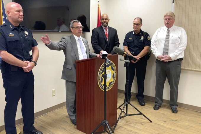 Hamilton County District Attorney Neal Pinkston, center, speaks at a news conference, Wednesday, June 9, 2021, in Chattanooga, Tenn. Law enforcement officials announced the closing a 42-year-old cold case of Samuel Pettyjohn, a Chattanooga businessman who was shot and killed in 1979 in a contract killing that former Gov. Ray Blanton's administration helped pay for. (AP Photo/Kimberlee Kruesi)