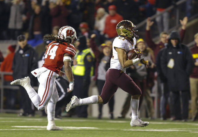 Minnesota running back Bryce Williams (21) runs for a touchdown against Wisconsin safety D'Cota Dixon (14) during the second half of an NCAA college football game Saturday, Nov. 24, 2018, in Madison, Wis. Minnesota won 37-15. (AP Photo/Andy Manis)
