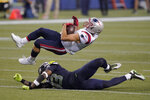 New England Patriots wide receiver Julian Edelman comes down with a pass reception over Seattle Seahawks strong safety Jamal Adams during the second half of an NFL football game, Sunday, Sept. 20, 2020, in Seattle. (AP Photo/Elaine Thompson)