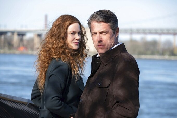 """This image released by HBO shows Nicole Kidman, left, and Hugh Grant in a scene from """"The Undoing,"""" debuting on Sunday at 9 p.m. EDT on HBO. (HBO via AP)"""