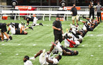 Atlanta Falcons stretch before practice during NFL football training camp Thursday, Sept. 3, 2020, in Atlanta. (Hyosub Shin/Atlanta Journal-Constitution via AP)